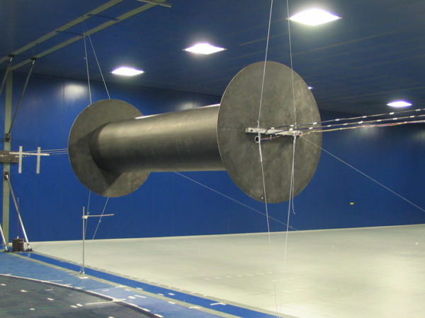 Vortex induced vibrations at high Reynolds numbers on circular cylinders